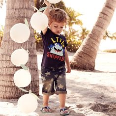 This shark tee and star print shorts are just perfect for a day at the beach.