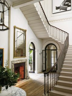 Rose Uniacke Interiors | Mad About The House- doorway under stairs, fireplace in foyer or vestibule
