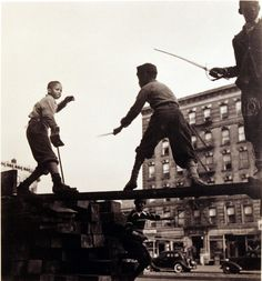 Aaron Siskind, Boys playing with toy swords,  Harlem, New York, ca. 1930-1940
