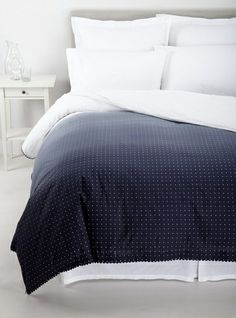 "Vera Wang Dip Dye Dots King Duvet Cover by Vera Wang. $299.99. 100% Cotton. Vera Wang Dip Dye Dots King Duvet Cover. 107"" x 92"". Seeing spots. Tiny dots add dimension to modern ombré in this decidedly chic collection from Vera Wang. Ikat-print European shams, delicately detailed sheeting and embellished decorative pillows complete this ensemble's luxe, fashion-forward allure."