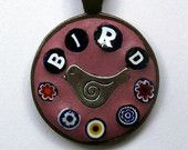 Bird and millefiori mosaic circular pendant