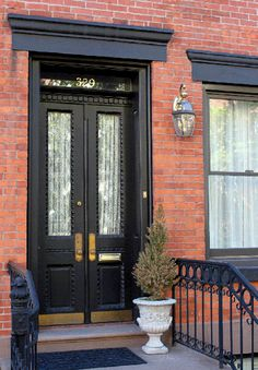 15 Black Front Door Designs To Inspire | Shelterness