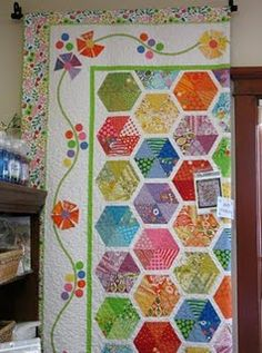 Love the colors in this hexagon quilt, and the narrow white sashing