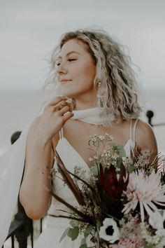 """This photo features a gorgeous alternative bride wearing a bohemian wedding dress. Pictured also is a gorgeous bohemian wedding hair style fit for any """"hair styles for wavy hair"""" pinterest board. This eclectic bride is holding a gorgeous fall wedding bouquet and has a stunning artistic wedding ring on. She was photographed by the Rocky Mountain Elopement Photographer, Emily Crisp. If you'd like to work with this eastern tennessee wedding phtographer, visit her website! Bohemian Wedding Hair, Bohemian Bride, Bohemian Style, Smoky Mountain Wedding, Mountain Elopement, Fall Wedding Bouquets, Flower Bouquet Wedding, Elope Wedding, Wedding Ring"""