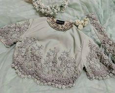 Ivory lace embellished crop top gorgeous ivory lace embellished crop top with le Stylish Blouse Design, Fancy Blouse Designs, Sari Blouse Designs, Designer Blouse Patterns, Lehenga Designs, Saree Jacket Designs, Sari Design, Indian Designer Outfits, Indian Outfits