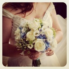Blue hydrangea wedding bouquet Blue hydrangeas, white agapanthus, green bells of Ireland, white roses