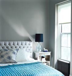 bedrooms - Benjamin Moore - Rushing River - tufting tufted bed blue glass lamp turquoise blue throw gray walls Gay walls, white tuftted headboard,