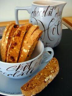 Oatmeal Cookie Biscotti  (flour, oats, baking soda, baking powder, salt, cinnamon, cardomom, eggs, sugar, vanilla, sultanas)