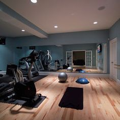 home gym in basement... great floors, color, and use of mirrors