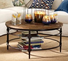 Round pottery barn coffee table with adjustable wrought iron legs and parquet…