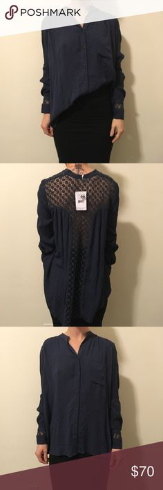 NWT FREE PEOPLE Navy Crochet Button Down Shirt Top New with tags Free People shirt with long sleeves and a Button Down center- Crochet exposed back Panel and has buttons on either sides ends. Really cute and is a gorgeous color- size extra small. Free People Tops Button Down Shirts