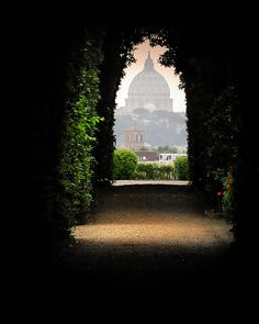 View of the Vatican through a garden gate keyhole.