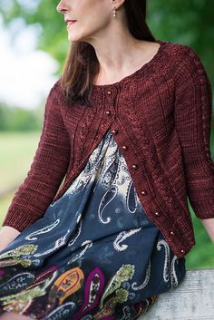Sorrelle is the quintessential cardigan, perfect for wearing over dresses or with pants and boots. It has a pretty acorn like pattern around the yoke from which cables flow down the front and sleeves and vertical lines down the body. Sorrelle is the feminine variation of Sorrel meaning redish brown which describes the beautiful color of the cardigan. I used Polka Dot Sheep Stumptown Dk. This was my first time working with it and found it wonderful. It is very soft and has great stitch…