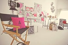 Love the mix of bright pink with black and white. Love the newspapers as well.