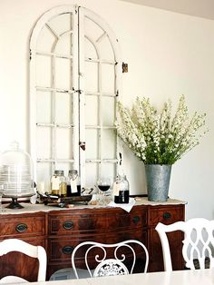 Old arched Window, lovely mix of wood tones, metals, chippy whites