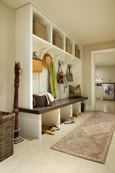 Fifteen-inch cubbies in the lower level mudroom are very accommodating, and a great space for storing out-of-season items. - Traditional Home ® / Photo: Werner Straube / Design: Rosemary Merrill
