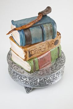 they are all cakes stacked and the wand is chocolate and butterscotch. Harry Potter Treats, Harry Potter Cake, Different Types Of Cakes, Book Cakes, Crazy Cakes, Retirement Parties, Cupcake Cakes, Cupcake Ideas, Cake Creations
