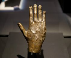 Arabian Bronze Hand by Jade Koekoe -- This bronze hand was found in Yemen (100-300 CE). The inscription on the hand asks for good fortune for the devotee Ta'lab.  This image was taken at the National Museum of Australia in the travelling exhibition A History of the World in 100 (and 1) Objects.