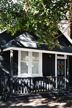"The home's exterior facade is painted in Dulux 'Domino'. ""I really wanted the house to be dark, which is similar to the little summer cottages you see on the lakes in Sweden,"" says Libby. Coastal Cottage, Cottage, Exterior House Colors, Country Home Exteriors, Exterior Design, Dark House, Weatherboard House, House Painting, Australian Homes"