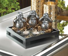 Invite peace and serenity into your home with this No Evil Buddha Candle Garden and remind everyone to speak no evil, hear no evil, and see no evil. The wooden frame of this serenity garden is filled