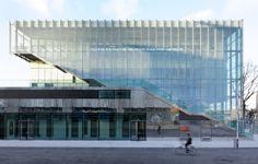 A layer of glass louvres wraps this Paris sports centre by Dietmar Feichtinger Architectes, forming a semi-transparent facade Architecture Design, Amazing Architecture, Contemporary Architecture, Indoor Climbing Wall, Pont Paris, Sport Hall, Glass Facades, Paris Ville, Concert Hall