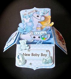 3D New Baby Boy Rubber Band Pop Up Box Card on Craftsuprint designed by Carol Clarke - made by Cynthia Massey - Followed the very easy instructions and diagrams using shearing elastic for the pop up structure which works perfectly, I used a mixture of Carols embellishments and some of my own, I think I went over the top but this has made an awesome card which really has the WOW factor, I just love these kits