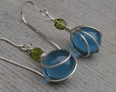 These colors make me think of summer-  Little Teal Glass Marbles with Olive Green by nicholasandfelice, $ 16.50