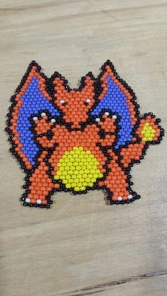 Brick stitch Charizard commissioned by a friend. Again, there are no Pokemon brick stich patterns anywhere! So I made one.