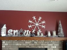 Winter mantle...to help curb the blah feeling after taking all the Christmas decorations down. Turn on the small string of lights at night to add some twinkle.