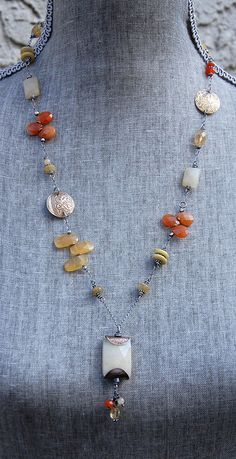necklace with honey jade pendant, handmade bead caps, citrine, carnelian, etched brass, and sterling silver