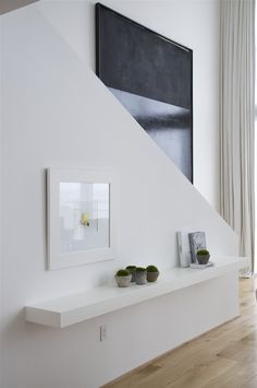 Simple white floating shelf and art - Biscayne Blvd. Penthouse Briggs Edward Solomon