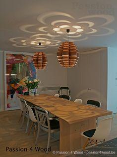 Glow lamp in walnut hout above table in oak