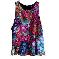 NEVER WORN Peplum tank top Floral pattern peplum tank top with t-shaped back strap. Super cute paired with skinnies and heels! Purchased in a boutique and I have never worn it because it's too big on me. Tags were removed Anna Grace Tops Tank Tops