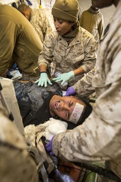 U.S. Navy Cmdr. Georgina Zuniga, an emergency room nurse with 1st Medical Battalion, 1st Marine Division (1STMARDIV), performs a patient assessment during Exercise Steel Knight 15 (SK-15) shock trauma training scenario aboard Marine Corps Air Ground Combat Center Twentynine Palms, Calif., Dec. 13, 2014. SK-15 is an annual training exercise developed to prepare 1STMARDIV personnel to execute military operations as a Ground Combat Element within a Marine Air-Ground Task Force. (U.S. Marine…