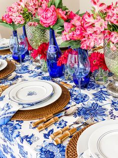 A perfect set of bistro plates, each with a different design, and faux bright pink peonies became the foundation for my cobalt blue and pink floral table. Moroccan Party, Floral Tablecloth, Backdrops For Parties, Party Entertainment, Floral Centerpieces, Pink Peonies, White Decor, Antique Bottles, Vintage Bottles