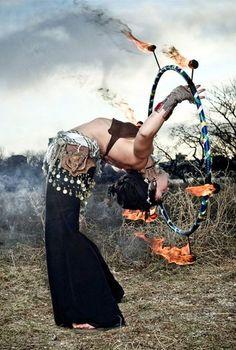 Gypsy fire dancer.