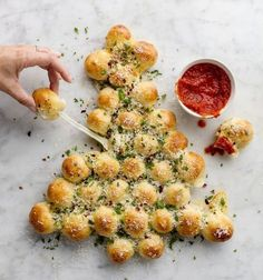 Yummy, Cheesy,Pull-Apart Christmas Tree. Super Simple. Wrap pieces of string cheese in pizza dough, form tree, bake, brush with melted butter and herbs. EAT and ENJOY