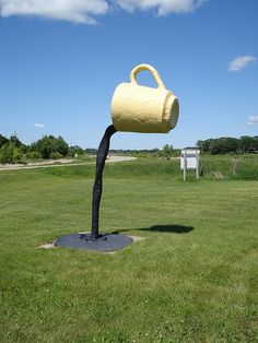 Giant coffee cup - Vining, MN Artist Ken Nyberg. I would love to have this in my yard. I might twine morning glories up the coffee stream. :)