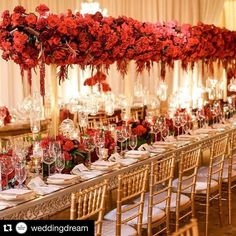 #red #wedding   Are you ready for fall weddings? Red and gold will certainly be the ultimate autumn color! We're head over heels in love with this wedding decoration by @squarerootdesign. Adoring this red roses table centerpiece that builds such a vivid ambiance. Together with hanging candles and glass elements this reception is truly elegant and heartwarming. Who loves this as much as we do? Leave your answer below!  Event Desing @squarerootdesign / Photographer @brandonkiddphoto…