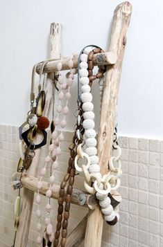 """""""Vintage"""" looking ladder used for storage of jewlery - could hang towels and other stuff on there too for a bathroom."""