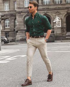 Green polo and khakis.