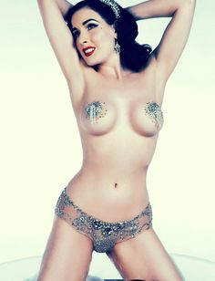 A close-up of Dita Von Teese in one of her sets of bejeweled pasties and panties for her martini glass act.