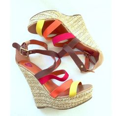 "Bebe 2b summer multicolored wedge. Gorgeous wedge with multicolored straps. Comfortable all man made materials. Insole is lightly padded for comfort. Gold hardware buckle closure. Wedge 6"", front is 1.5"". Hardly used, in excellent condition. 2b BeBe Shoes Wedges"