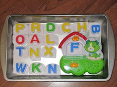 Play Adventures: Car Activities for 18-month-old--cake pan with magnets- THOUGHT this was cute until I pictured him throwing it at his siblings..or hitting them with pan :(