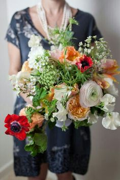"{""Free Form"" Bridal Bouquet Which Includes: Peach English Garden Roses, Red Poppies, White Sweet Peas, Pink/Orange Parrot Tulips, Coral Poppies, White/Pink Ranunculus, White Wax Flower, Green Air Plants, Green & White Queen Anne's Lace, & Several Varieties Of Greenery & Foliage······························}"