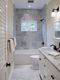 NIce granite for bathroom in jack and jill. Like how all the hardware matches the doorknobs and the window in the shower. Needs indented builtin space for shampoo bottles and soap