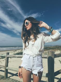 All white outfit for a summer day at the beach, wearing denim short and top with lace details.