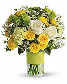 Your Sweet Smile. This dazzling bouquet includes white roses, yellow spray roses, green carnations, green button spray chrysanthemums and white waxflower accented with assorted greenery.