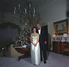 Lady Bird Johnson and President Lyndon B. Johnson pose with Christmas tree