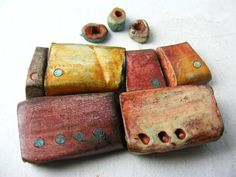 Amazing clay beads, burnished, patina, hand carved and imprinted. By greybirdstudio